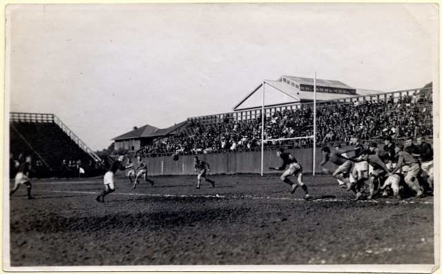 Berkeley High School Rugby Team, October 28, 1911. Norman Slater trying to block a kick from the full back of Oakland.