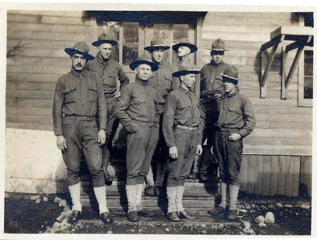 "Colby E. ""Babe"" Slater and other soldiers by building, circa 1918 Babe is second from left in back row."